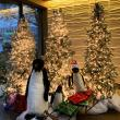 Winter holiday decoration with Christmas trees and penguins, created by ITG